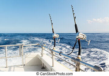 Deep sea fishing on a sunny day - Two rods and reels in...
