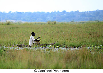 Fisherman - Lake Anapa - Uganda, Africa - Lake Anapa in...