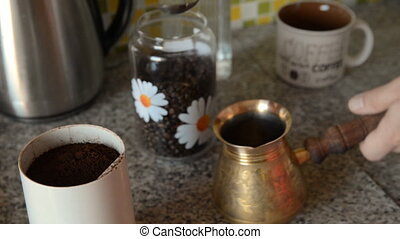 The home coffee in table. Coffee beans were grinded in an...