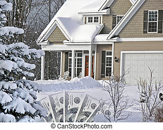 Home Mortgage - Money with new home in winter snow.