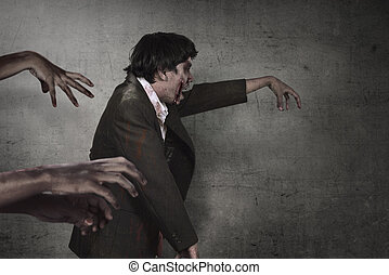 Aggressive asian zombies man with bloody hand walking...