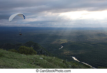 Big Air - A tandem paraglider soars of La Rampa near La...