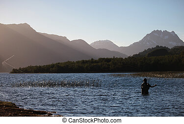Casting - A fly fisherman practices his craft on a pristine...
