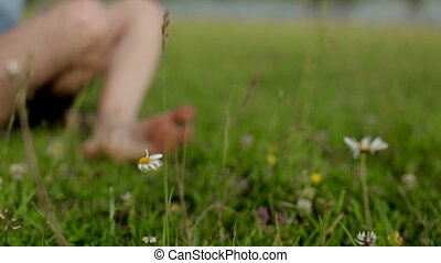 girl is resting on the meadow near the river