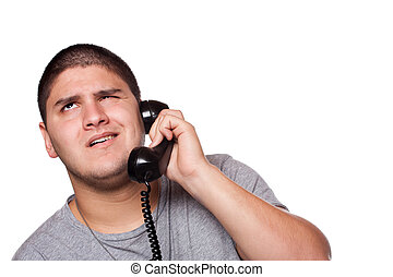 Frustrating Phone Conversation - A young man listens on the...