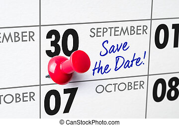 Wall calendar with a red pin - September 30