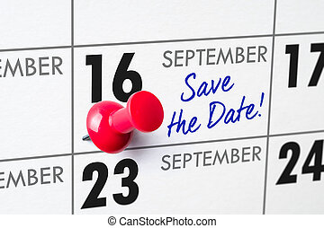 Wall calendar with a red pin - September 16