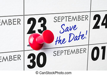 Wall calendar with a red pin - September 23