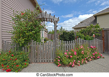 Garden in the back yard - Back yard with a small garden in...