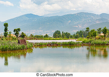 Lake and wood bridges with mountains in the background