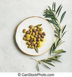 Pickled green Mediterranean olives in virgin olive oil,...