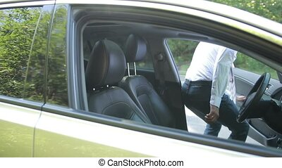 Businessman in car fastening seatbelt - Handsome young...