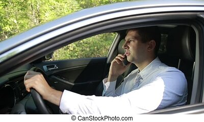 Busy bussinessman arguing on phone in car - Profile of young...