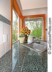 Kitchen sink - Granite countertop with kitchen sink in a...