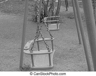 the swings in the Playground in Moscow in the summer