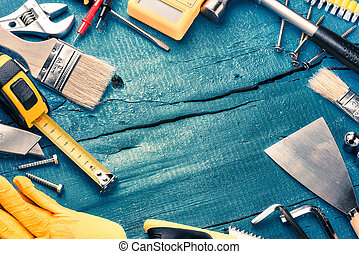Set of various tools on blue wooden background. Construction...