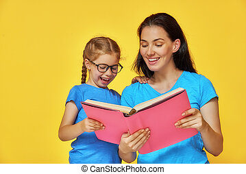 child and mother are reading the book - Back to school!...