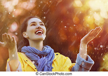 woman under the autumn shower - Happy beautiful young woman...
