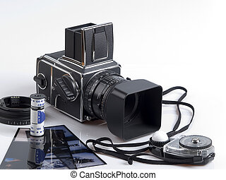 High End Camera - The photo shows a high end camera, a roll...