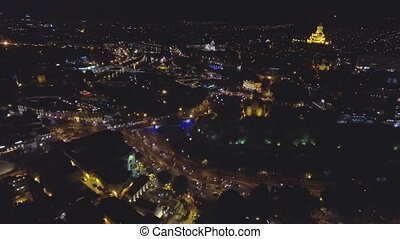Aerial View. Flying over night Tbilisi. - Flying over night...
