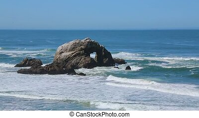 Rock with a heart shaped outline in the ocean. Seal Rock at...
