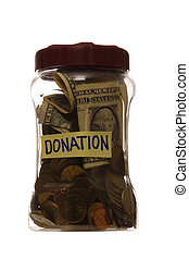 Donation in a jar - Donation with coins and dollar note in a...