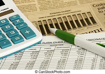 Spreadsheet - spreadsheet with pen,calculator and financial...