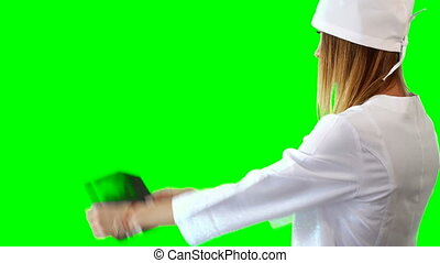 young doctor looking the xray on green chromakey