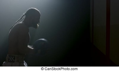 Fit man throwing medicine ball doing ball slam against gym...