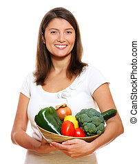 Young woman with vegetable basket