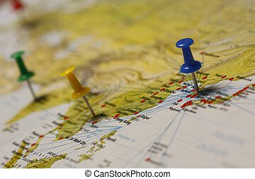 Travel Destination - A push pin is inserted on a travel...