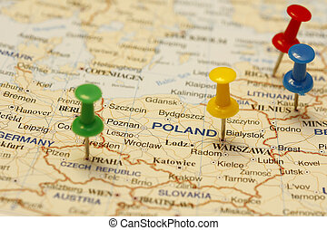 Push Pin In Poland - Push pin on an old map showing travel...