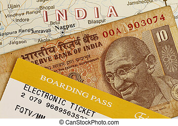 Trip to India concept with Indian rupee and baording pass