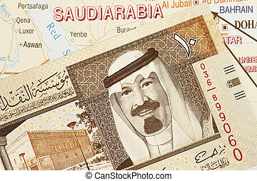 Saudi Arabia - Close up shot of Saudi Arabia money and map.