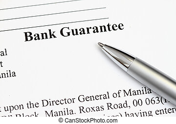 Bank Guarantee - Macro shot of Bank Guarantee with pen in...