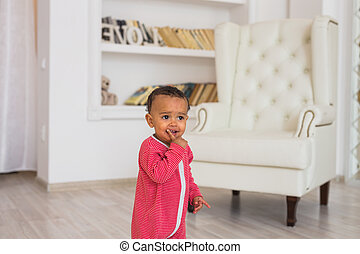 Portrait of mixed race kid at home