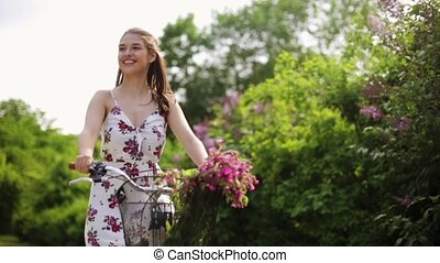 happy young woman riding fixie bicycle in summer - people,...