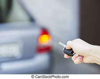 Hand locking the car with a key