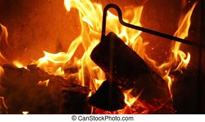 Flames of a fireplace - Burning fire, slow motion, hitting...