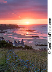 Setting sun on Mulberry Harbours at Arromanche - The...