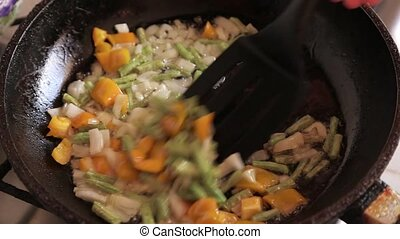 Beans fried with vegetables with onions and carrots