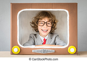 Child playing with cartoon TV - Child playing with cardboard...