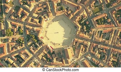 Aerial top down view of tiled roofs of symmetric Palmanova...