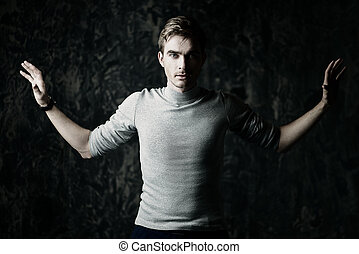 inner strength concept - A man stands with his arms...