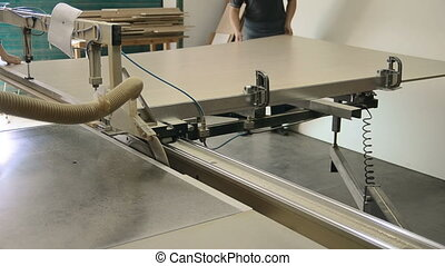 Production of cabinet furniture, sawing, materials on a...