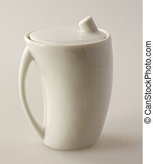 Sugar bowl - White sugar bowl over a white background