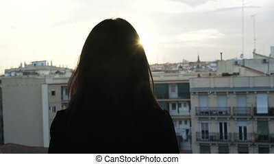 Madrid rooftop sunset. Woman enjoying the view