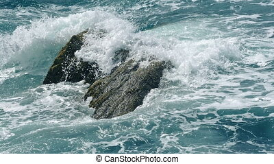 Big Waves Crash Over Rock In The Ocean - Dramatic shot of...