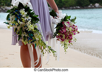 Bridesmaid. - Close-up of a bridesmaid holding bouquets on...