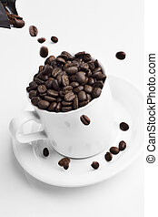 Pouring coffee beans into a coffee cup